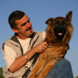 German shepherd and man — Stock Photo