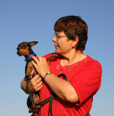 Miniature pinscher and woman — Stok fotoğraf