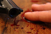Blood, pistol and death — Stock Photo