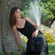 Woman and fountain — Stock Photo