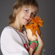 The girl embraces a doll — Stock Photo