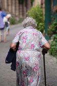 Elderly moving with a cane. — Stock Photo