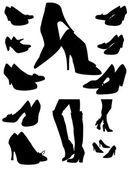 Silhouettes des chaussures noires — Vecteur