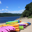 Stock Photo: Colourful Kayaks vertical
