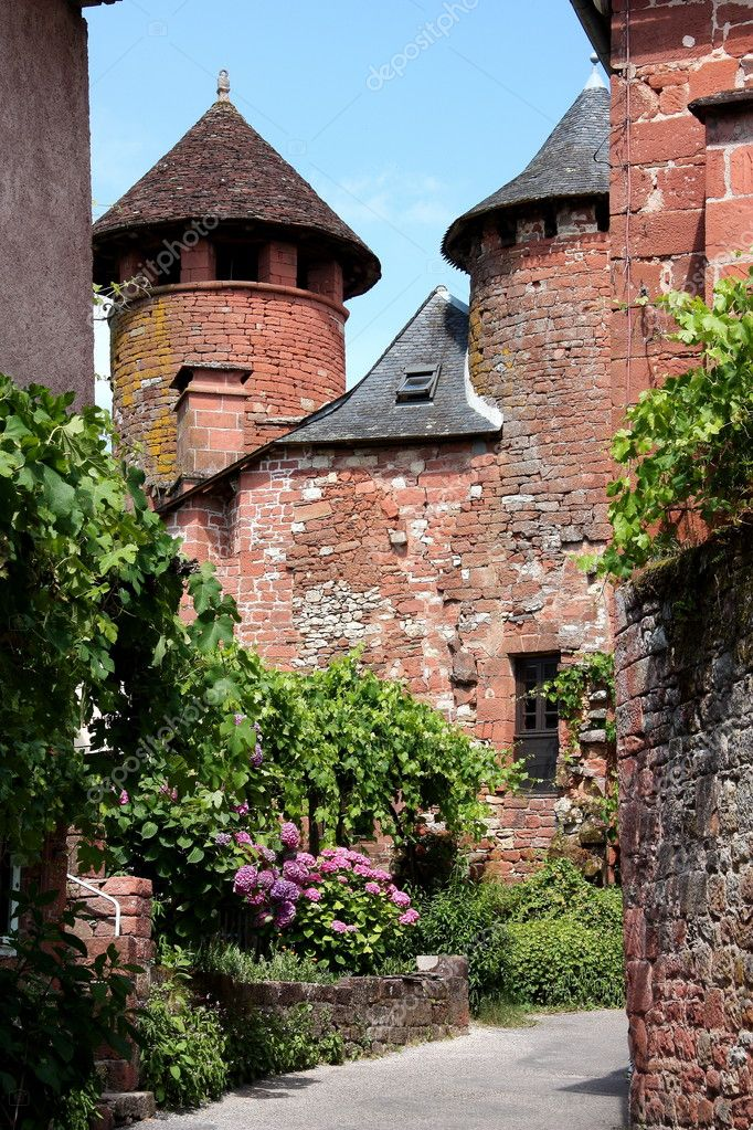 Collonges la Rouge is one of the 152 officially designated Most Beautiful Villages in France and is known for its unusual red stone architecture. — Stock Photo #1844455