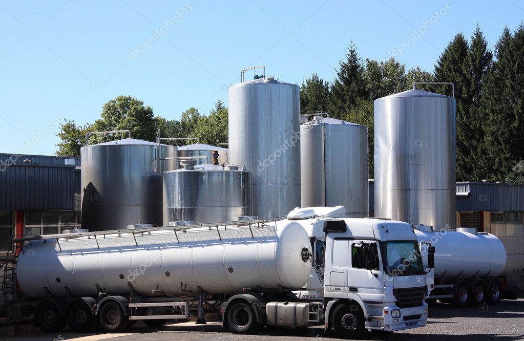 Refrigerated milk tankers make the early morning delivery of fresh milk to the dairy from the surrounding farms  — Stock Photo #1845893