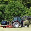 Stock Photo: Harvesting and wrapping hay