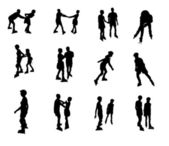 Silhouettes of inline skaters — Stock Photo