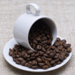 White coffee cup full of coffee bean — Stock Photo