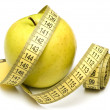 Yellow apple and measuring tape — Stock Photo