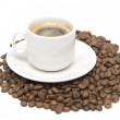 White coffee cup and coffee beans - Stock Photo