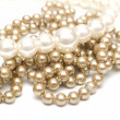 Beige and white pearl beads - Stock Photo