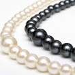 Stock Photo: Black and white pearl beads