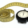Stop watch and measuring tape — Stock Photo