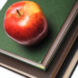 Red apple on stack of book — Stock Photo