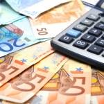 Calculator and paper euro — Stock Photo