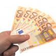 Male hand holding paper euro — Stock Photo