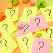 Sticky notes with question marks - Stock Photo