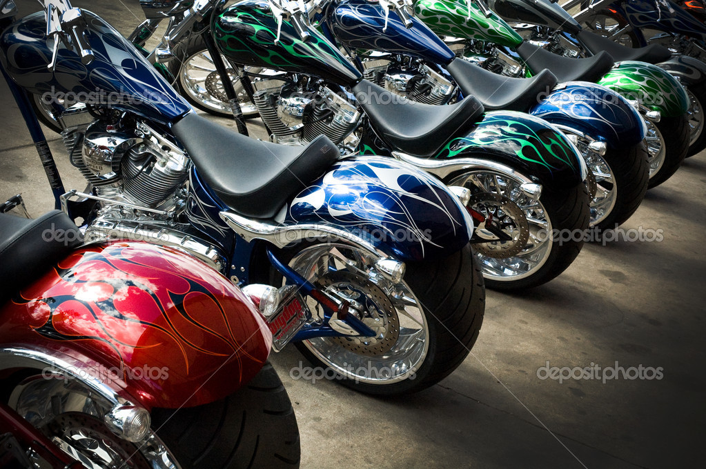 This is a photography of a line of custom motorcycles at a riding event.   Stock Photo #1938507