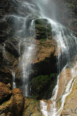 Waterfall Trickling Over Mossy Rocks in the Mountains — Stock Photo