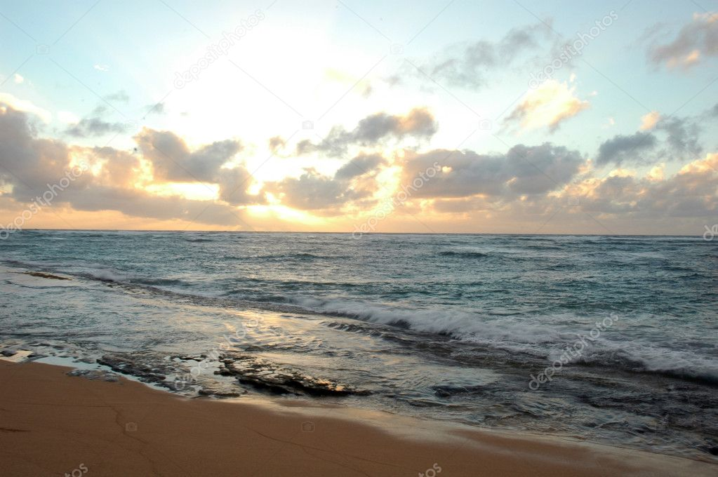 Photography of a beautiful sunset on the beach in Kauai, Hawaii  Stock Photo #2055100