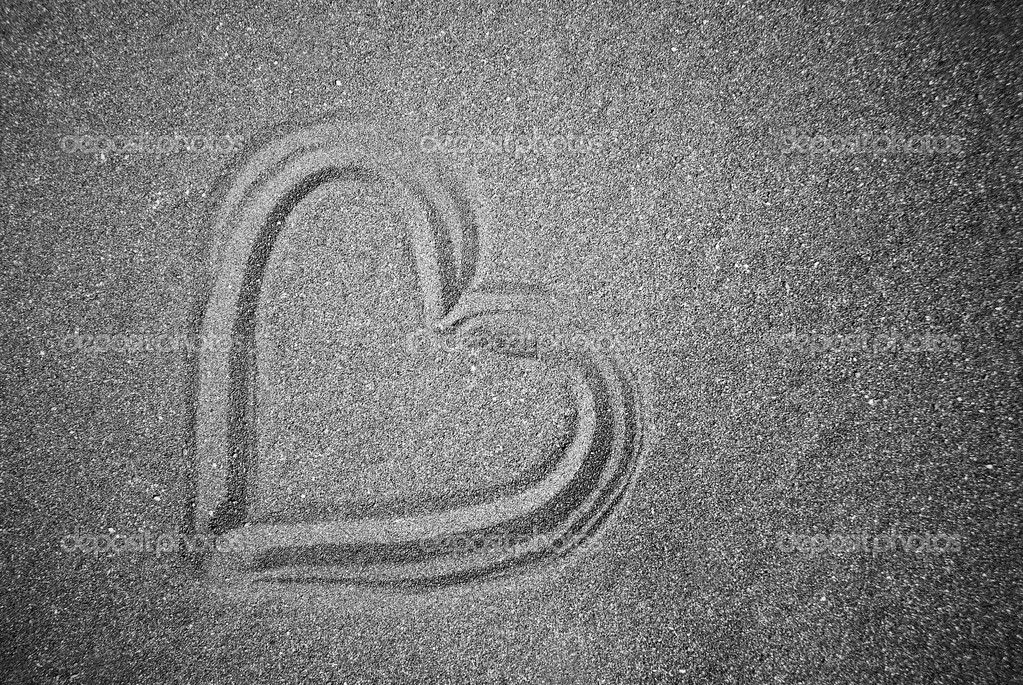 Black and White Photograph of a heart draw in the sand. — Stock Photo #2055204