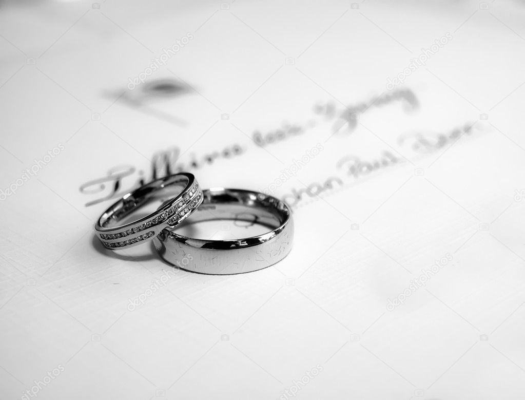 A pair of platinum wedding bands lying on Malta civil wedding certificate — Stock Photo #1796225