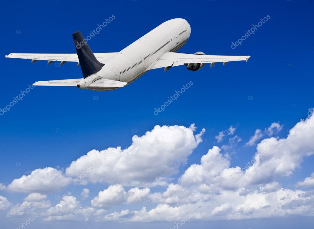 Civil aircraft flying into deep blue skies with some cloud — Stock Photo #2266994