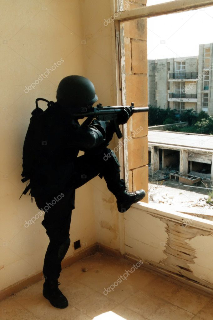 Member of Police special forces SWAT team during a real life mission — Stock Photo #2267321