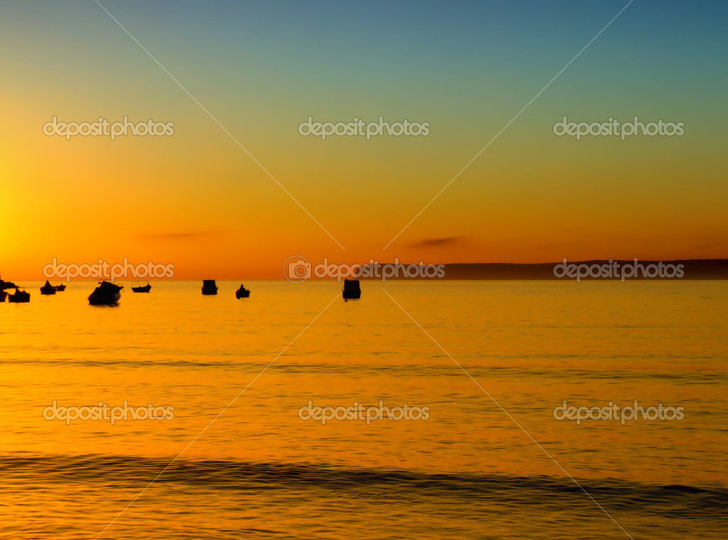 Typical Mediterranean sunset in a tranquil beach in Malta. — Stock Photo #2365441