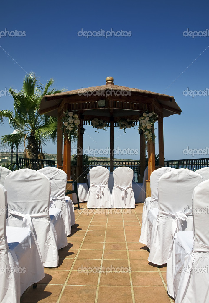 A Mediterranean wedding setting showing aisle and gazebo — Stock Photo #2376289