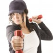 Woman with red dumbbells in hands — Stock Photo