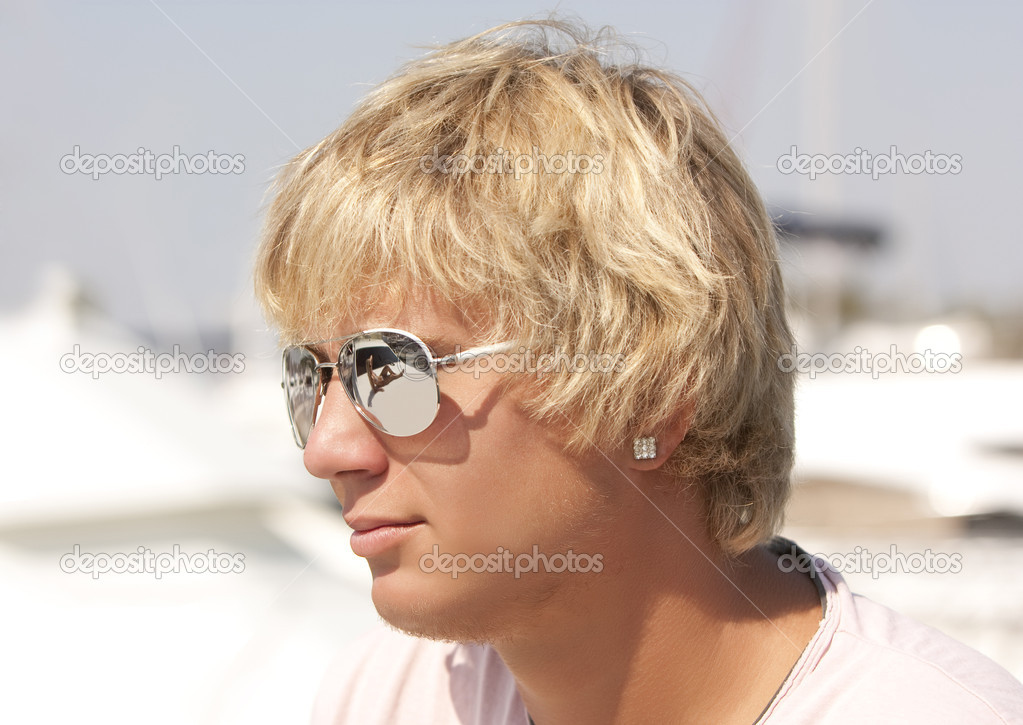 Fashionable young blond man in sun glasses  Stock Photo #1863753