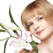 Stock Photo: Women with a lily flower