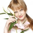 Women with a lily flower — Stock Photo