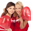 Two  girls with red heart balloon - Stock Photo