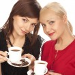 Two girls drinking coffee — Stock Photo