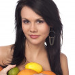 Beautiful brunette with citrus — Stock Photo