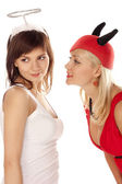 Angel and devil girls over white — Stock Photo