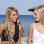 Two beautiful girls on a beach — Stock Photo
