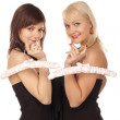 Two girls with pink hangers — Stock Photo
