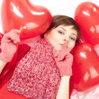 Woman with red heart balloon — Stockfoto
