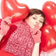 Woman with red heart balloon — Stock fotografie