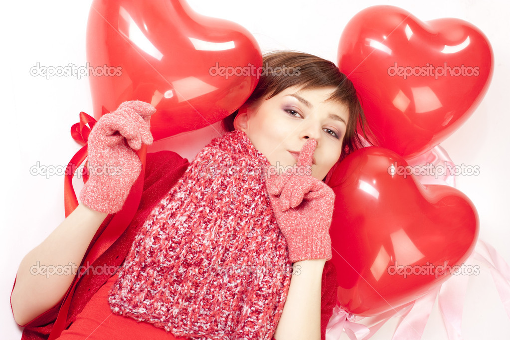 Woman with red heart balloon on a white background — Stock Photo #2291455