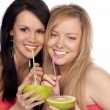 Stock Photo: Blonde and the brunette drink juice