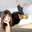 Beautiful smiling girl with green apples — Stock Photo