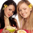 Beautiful girls with citruses — Stock Photo