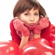 Girl with red heart balloon — Stock Photo