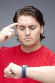 Man looking at wristwatch — Stock Photo