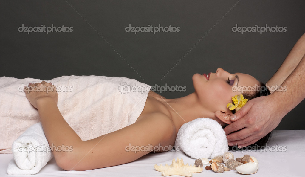 Beautiful young woman getting a spa treatment  Stock Photo #2382382